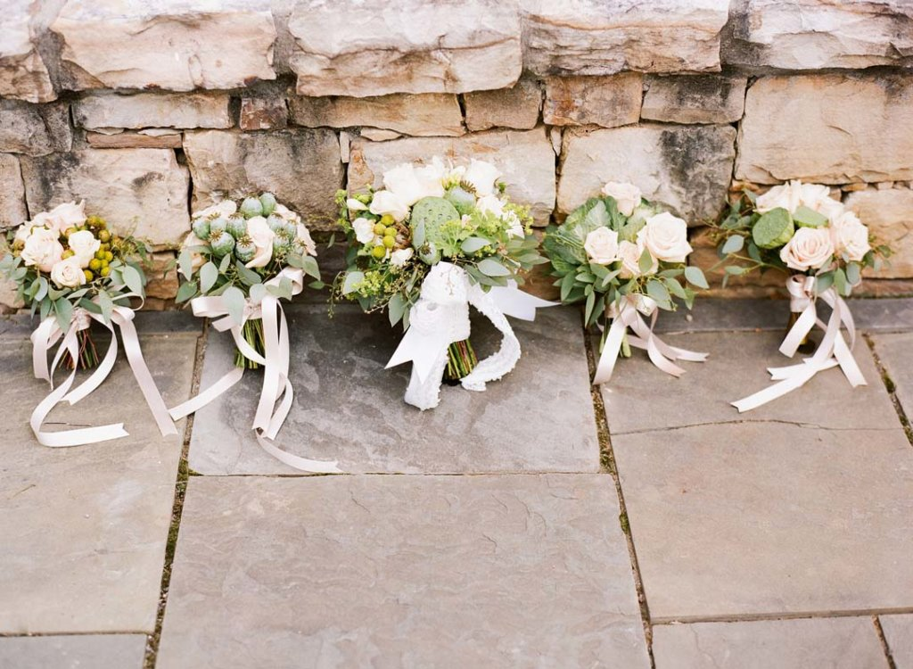 bride's and bridesmaids' bouquets in white and green with New Zealand accents