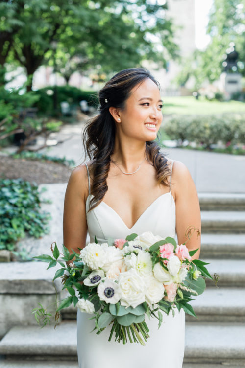 a white bridal bouquet with blush accents