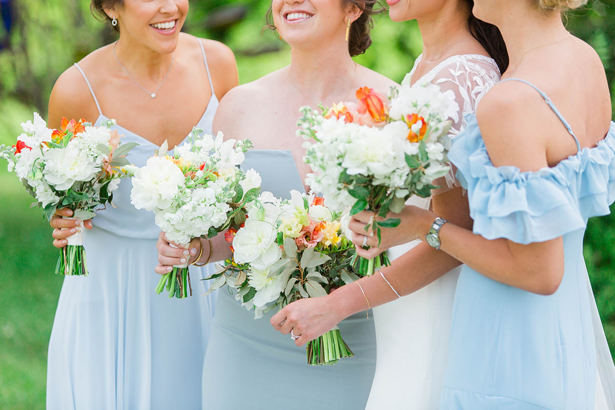 Bridesmaids in light blue holding bouquets - Bellwether Events