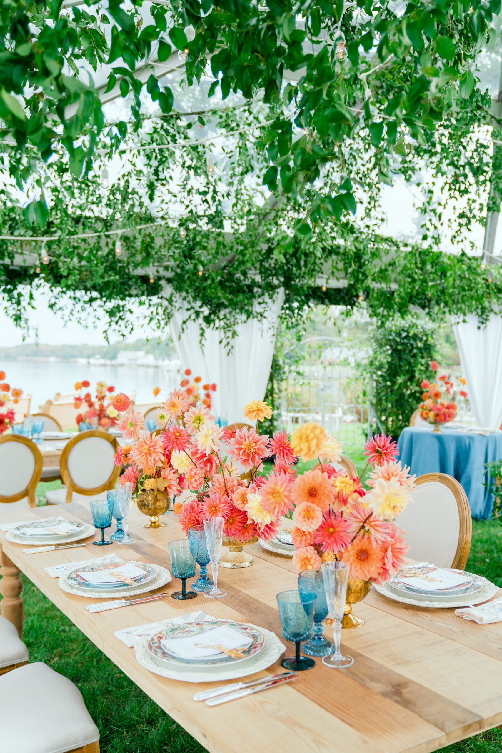 colorful coral centerpieces on farm tables - Waterfront Wedding Southern Maryland Bellwether Events Kurstin Roe Photography Sugarplum Tent Co